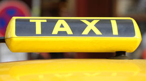 Taxi sign. On car in the street Royalty Free Stock Images