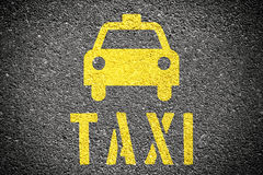 Taxi Sign. On the asphalt Stock Images