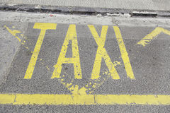 Taxi sign on asphalt Stock Image