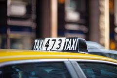 Taxi sign. In big city close up Royalty Free Stock Photography
