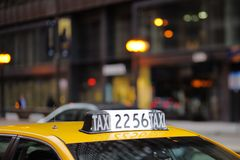 Taxi sign in big city Royalty Free Stock Image