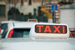 Taxi sign on a cab Stock Photo