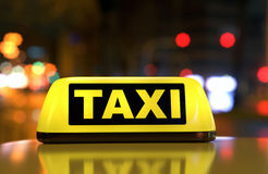 Taxi sign on car Royalty Free Stock Images