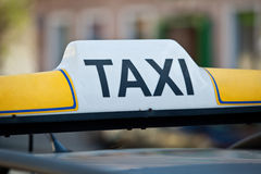 Taxi sign on a car roof Royalty Free Stock Images