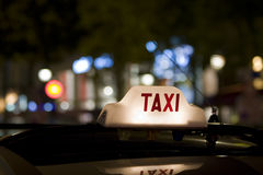Taxi sign on car roof Stock Images