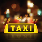 Taxi sign on car roof Royalty Free Stock Image
