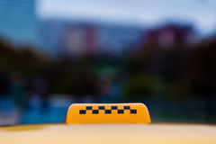 Taxi sign on car roof. Royalty Free Stock Photo