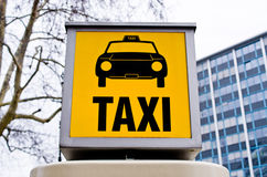 Taxi sign with car Stock Image