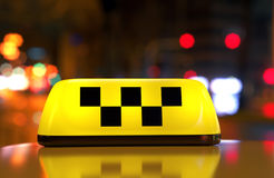 Taxi sign with checker Royalty Free Stock Image