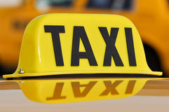 Taxi Sign Close Up. With Car in Background stock photography