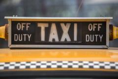 A taxi sign Stock Photos