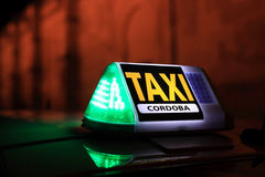 Taxi sign in Cordoba, Spain. Taxi sign illuminated at night in Cordoba, Andalusia Spain Stock Photo