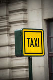 Taxi sign during Stock Images