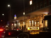 Taxi sign German. Taxi sign on the roof of a taxi at night Stock Photo