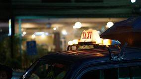 Taxi sign illuminate at night wait for passenger disrupted transportation indutry. Taxi sign illuminate at night wait for passenger disrupted indutry stock photos