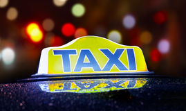Taxi sign. Illuminated at night Royalty Free Stock Photography