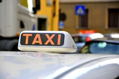 Taxi sign in Italy. Taxi sign on a white car in Italy Royalty Free Stock Image