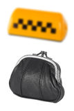 Taxi sign and a leather purse Royalty Free Stock Image
