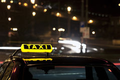 Taxi sign at night. A photo of a taxi sign on a top of a taxi car at night Royalty Free Stock Image