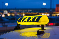 Taxi sign at night Royalty Free Stock Photos