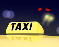 Taxi sign at night. Traffic Stock Photo