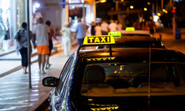 Taxi sign at night Stock Image
