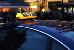 Taxi sign at night Royalty Free Stock Photography