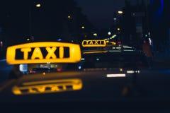 Taxi sign at night , taxi cars. Taxi sign at night - taxi cars Stock Photos