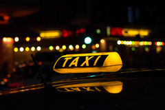Taxi sign at night , taxi cars Stock Image