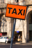 Taxi sign orange. Taxi sign with black lettering and orange background Stock Photos
