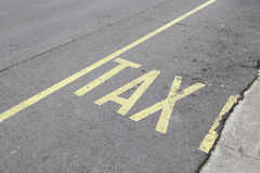 Taxi sign painted on asphalt Stock Image