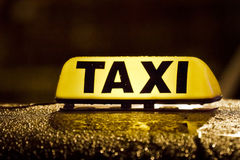 Taxi sign in rainy day Royalty Free Stock Image