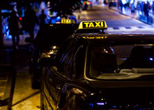Taxi sign on the roof of a car Royalty Free Stock Photography