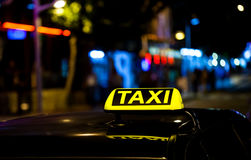 Taxi sign on the roof of a car Stock Images