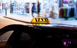 Taxi sign on the roof of a car Stock Photos