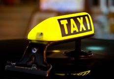 Taxi sign on the roof of a car Royalty Free Stock Photo