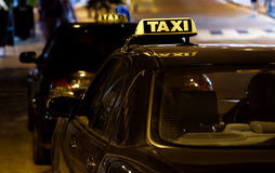 Taxi sign on the roof of a car Stock Image