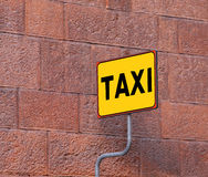 TAXI sign on the taxi stop with a old brick wall Royalty Free Stock Image