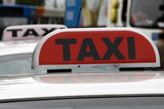 Taxi sign on top of car Royalty Free Stock Photography