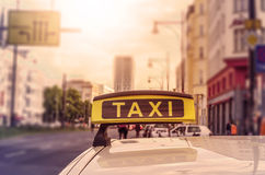 Taxi Sign. On top of a german cab in the evening sun, intentional selective focus Stock Photos