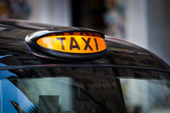 Taxi sign in UK Royalty Free Stock Photos