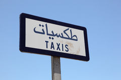 Taxi sign written in Arabic Stock Image