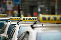 Taxi signs. Closeup Photo Of Taxi Signs Stock Image