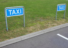Taxi Signs at Empty Parking Place in Perspective Stock Photos