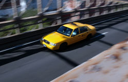 Taxi speeding over a bridge Royalty Free Stock Images