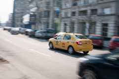 Taxi speeding Stock Images