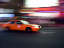 Taxi speeds through the streets. A New York City taxi speeds down the road Royalty Free Stock Image