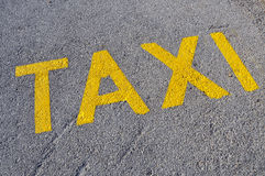 Taxi stand sign painted on the street Stock Image