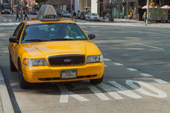 Taxi is standing at the curb Stock Photos
