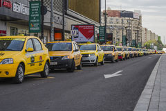 Taxi station. Row of yellow taxis lined up in the station on April22, 2014 in Bucharest, Romania Stock Photo